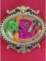Golden Thali With Rakhi and Tilak
